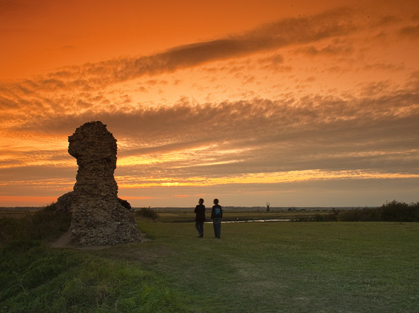 Burgh Castle at sunset, overlooking Haddiscoe Marshes