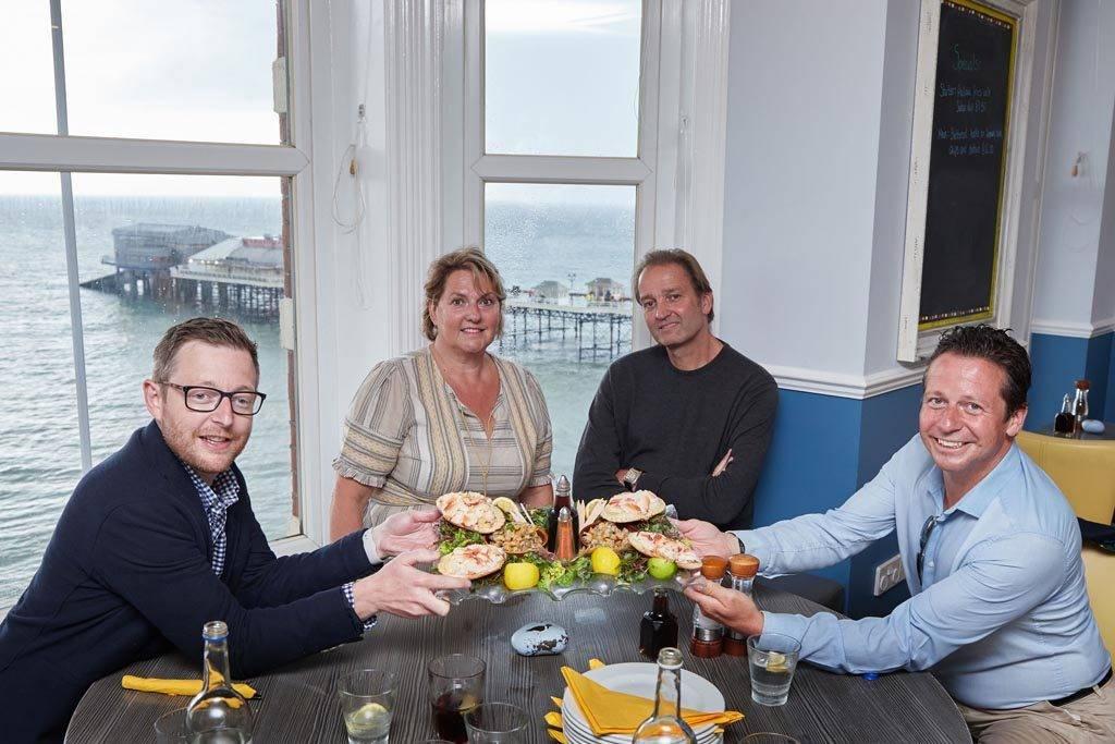 Nigel Huddleston MP enjoys Cromer crab with Tracy and Galton Blackiston of No 1 Restaurant Cromer and North Norfolk MP Duncan Baker.