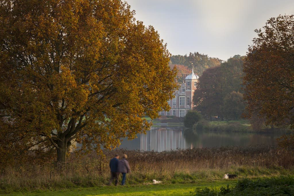 A couple walking around the lake at Blickling (credit) National Trust Images Justin Minns